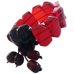 An Art Deco Cherry Amber bakelite bracelet in two colours with a huge heart