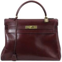 1960 Hermes Vintage Kelly Bag in Burgundy Leather with Golden Hardware