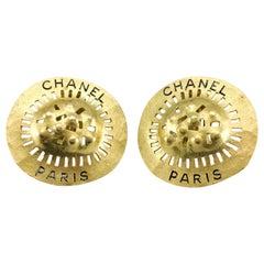 1994 Chanel Shield-Like Medallion Gilt Earrings
