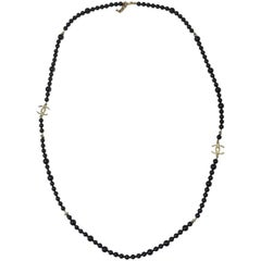 CHANEL Necklace in Black Pearls and Gilded CC