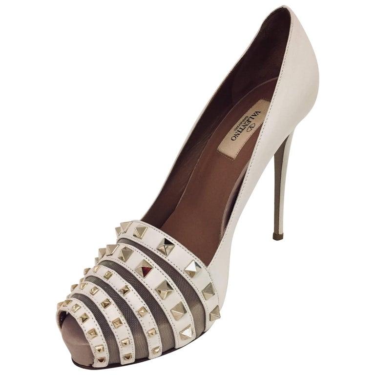 46a50b57e695 Valentino Ivory Rock Stud Peep Toe Platform Pumps For Sale at 1stdibs
