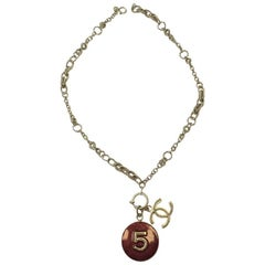 CHANEL Pendant N°5 and CC Necklace in Gilded Metal and Burgundy Resin
