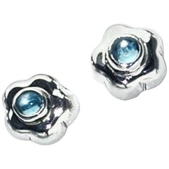 Silver Flowers with Blue Topaz Centers Stud Earrings