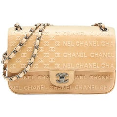 CHANEL 'Timeless' Flap Bag in Beige Embossed 'CHANEL' and 'CC' Lambskin Leather