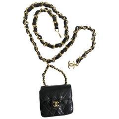 Vintage CHANEL mini 2.55 bag charm chain leather belt with golden CC charm.