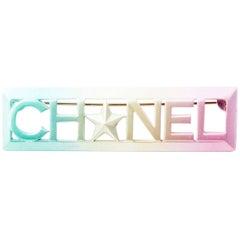 CHANEL Brooch 'CHANEL' in Tricolor Metal