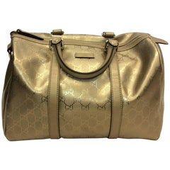 Gucci Logo Gold Metallic Speedy