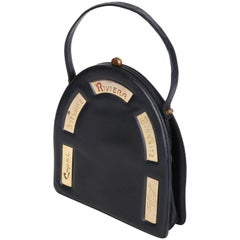 Prestige Black Leather Destination Arched Handbag with City Names, 1960s