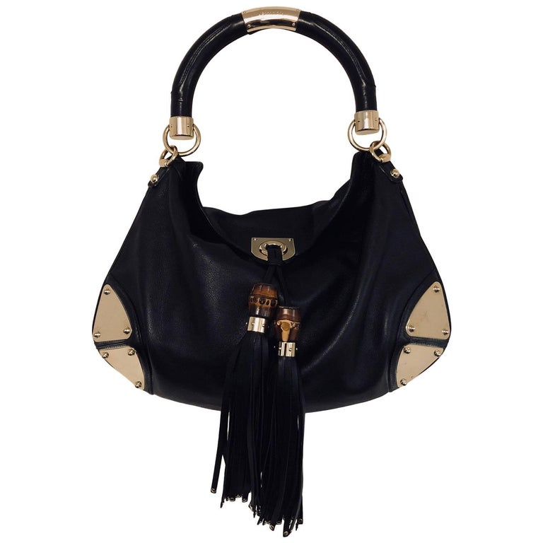 1fbb0e90126 Gorgeous Gucci Black Leather Indy Bag With Bamboo Tassels And Gold. Prevnext