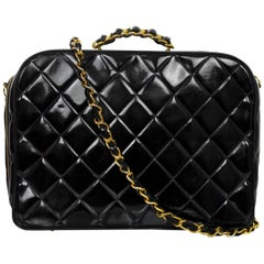 Chanel '90s Vintage Black Quilted Patent Travel Bag w/ Strap
