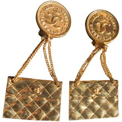 Vintage CHANEL classic 2.55 bag design dangling earrings with CC mark.