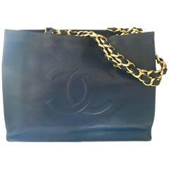 Vintage CHANEL navy calfskin large golden chain shoulder tote bag with large CC.