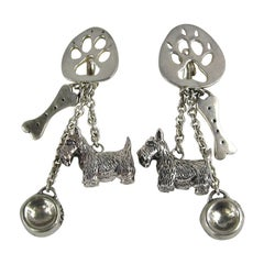 Sterling Silver Susan Cummings Dog Bone Dish Dangle earrings New, Never WORN