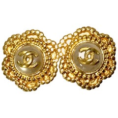 Vintage CHANEL golden six petal flower design earrings. CC mark and faux pearl.