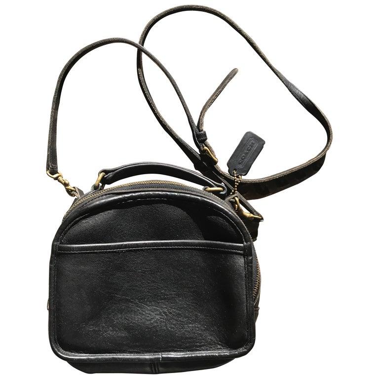 Vintage COACH genuine black leather oval lunchbox shape shoulder bag. USA made.