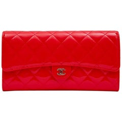 CHANEL Classic Clutch in Coral Varnished Quilted Leather