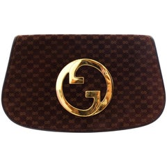 1972 Gucci Blondie Gold Emblem Monogram Clutch