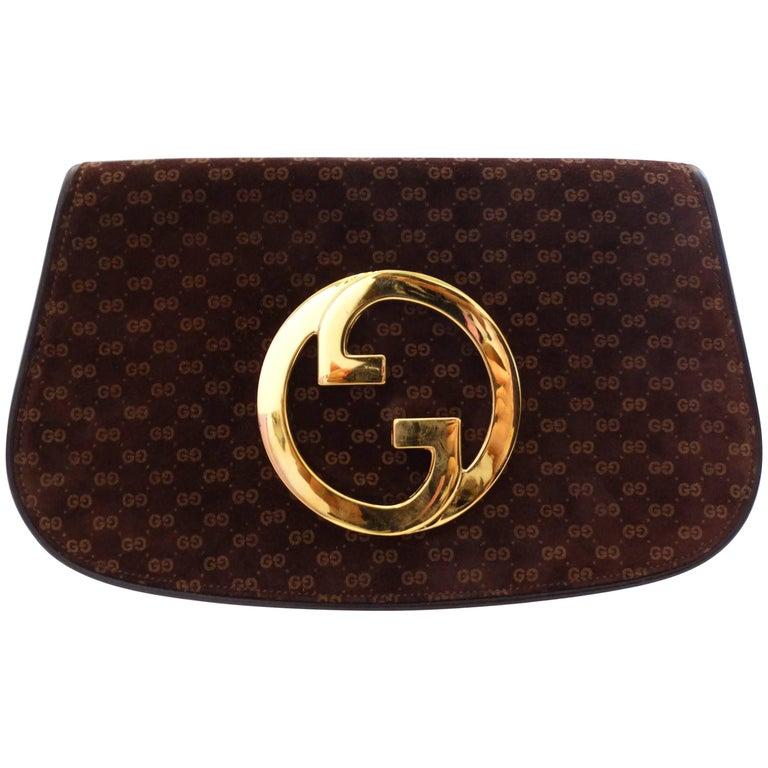 1972 Gucci Blondie Gold Emblem Monogram Clutch