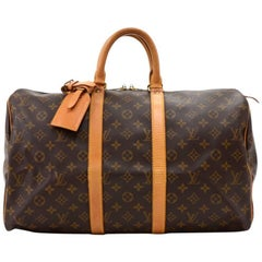 Vintage Louis Vuitton Keepall 45 is a classic of the Louis Vuitton travel bag co