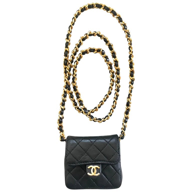 Vintage Chanel black mini 2.55 bag/necklace with long chain and leather strap.