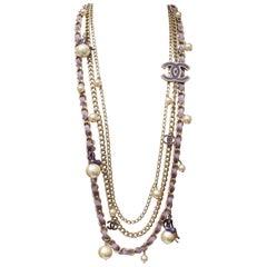 """Chanel """"Coco sur le monde"""" multistrand sautoir in silver tone and purple, 2004"""