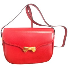 MINT. Vintage Nina Ricci red grained leather shoulder bag with golden logo bow