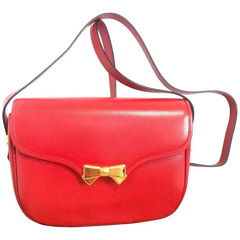 MINT. Vintage Nina Ricci red grained leather shoulder bag with golden logo bow