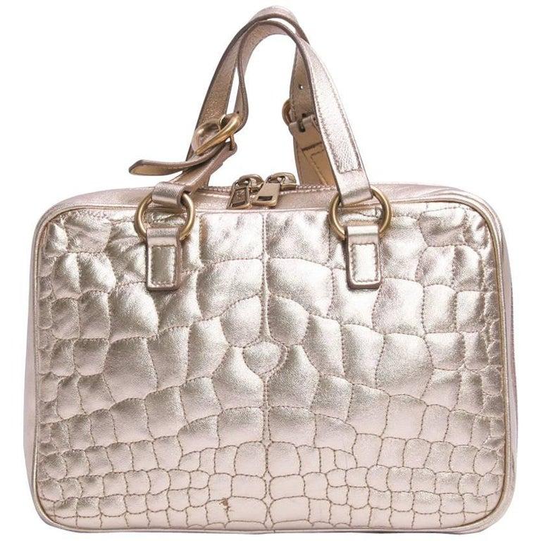 YVES SAINT LAURENT Mini Bag in Gilded Leather