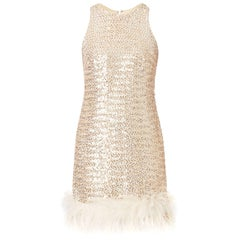 Silver sequin mini dress with feather trim, circa 1965