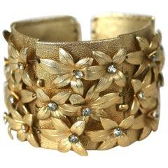 Napier Gilt Flower Cuff Bracelet