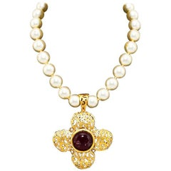 1970s Chanel Pearl Necklace with Gold Tone Filigree Pendant and Red Poured Glass