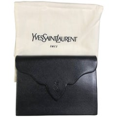 Vintage Yves Saint Laurent genuine black leather clutch purse with beak tip flap