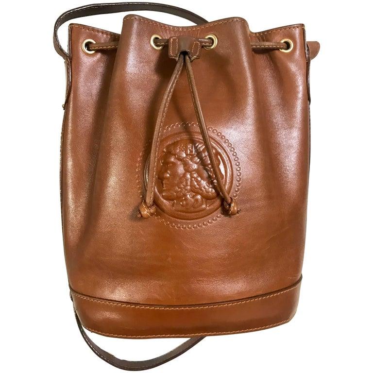 Vintage FENDI brown leather hobo bucket, shoulder bag with drawstring and Janus.