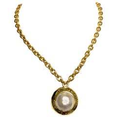Vintage CHANEL golden chain necklace with round faux pearl and logo pendant top.