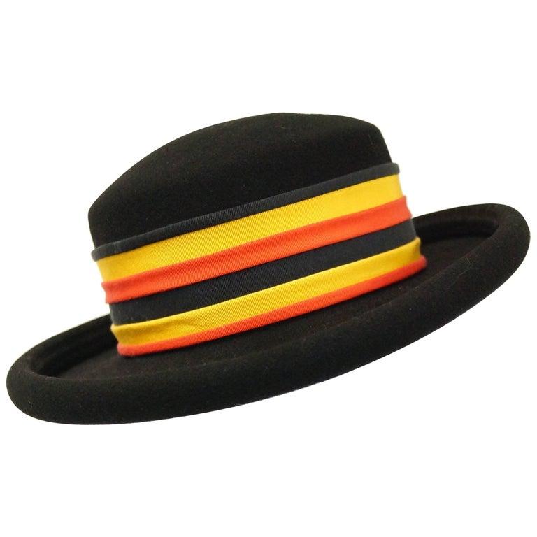 M 1980s Adolfo Black Felt Hat with Yellow and Orange Ribbon