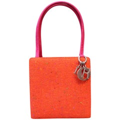 Christian Dior Small Lady Dior bag in orange wool and fuchsia satin