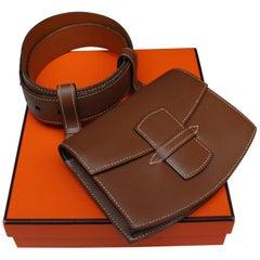 Hermès brown leather belt and clutch