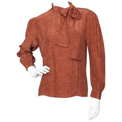 An Early 1980s Vintage Red Yves Saint Laurent Rive Gauche Silk Blouse