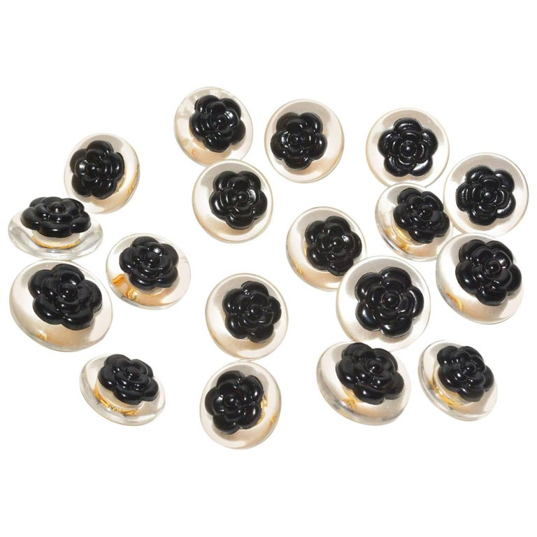 Chanel set of 18 Lucite and Black Camelia Buttons