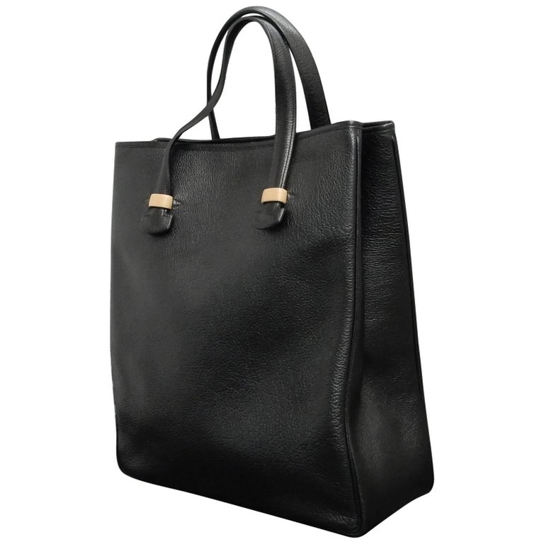 0ad4955642 Vintage 90s Hermes black calf leather tote bag. This shoulder tote bag is  rare
