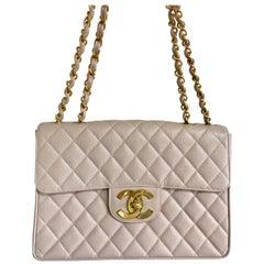 MINT. 1990s. Vintage CHANEL beige jumbo/large 2.55 caviar leather shoulder bag.