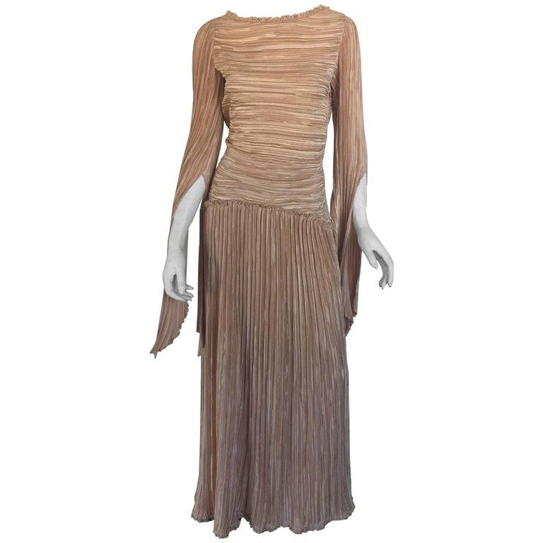 Mary McFadden nude draped sleeve pleated dress
