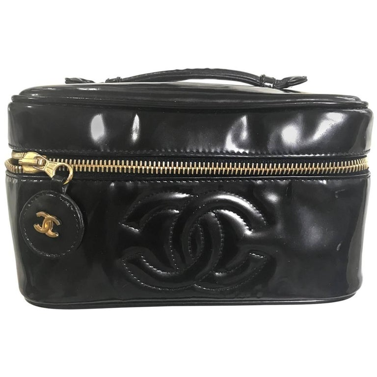 Chanel Vintage patent enamel cosmetic and toiletry black pouch purse with CC.