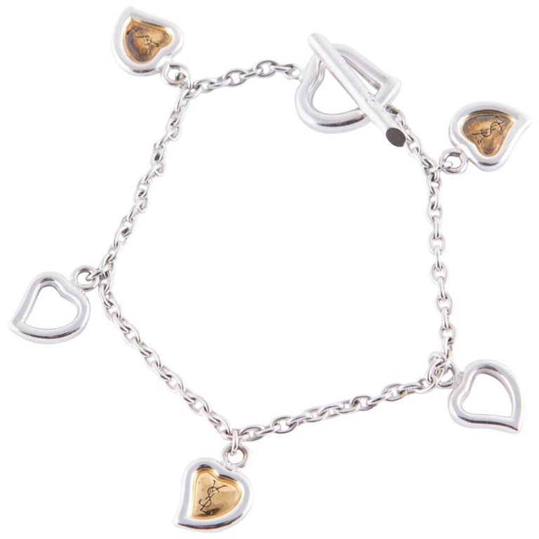 Yves saint laurent hearts charms bracelet for sale at 1stdibs - Bracelet yves saint laurent ...