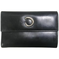 Vintage Cartier black leather wallet with silver tone kiss lock closure. Classic
