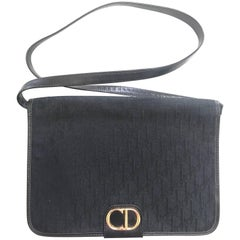 Vintage Christian Dior black logo jacquard shoulder bag, clutch with gold motif.
