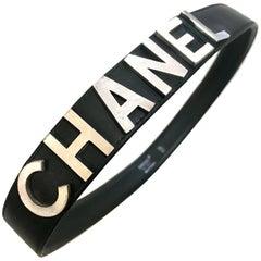 Vintage CHANEL black leather belt with silver logo motifs. Must have belt