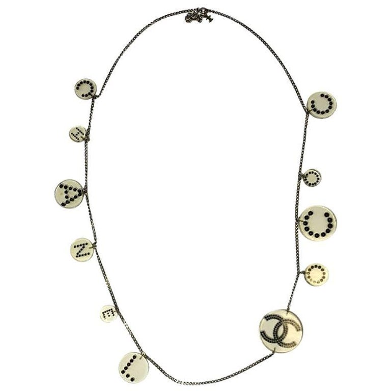 CHANEL Belt in Transparent Plexiglass and Black Pearls
