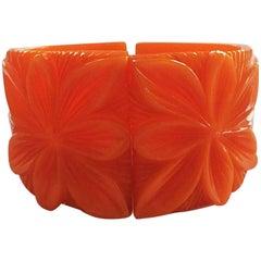 Art Deco Heavily carved orange bakelite clamper hinged bangle