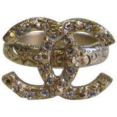 CHANEL CC Ring in Pale Gilded Metal set with Small White Rhinestones